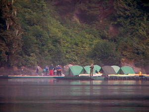 Floating docks with tent city and guests